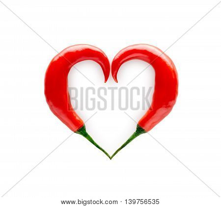 Chili peppers forming a heart shape isolated on white background