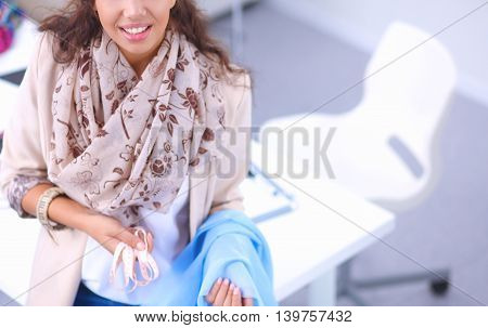 Portrait of beautiful female fashion designer working , isolated