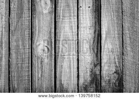 old rough timber fence planks with a old weathered look