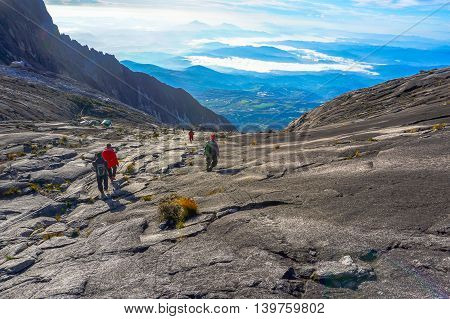 Ranau,Sabah,Borneo-March 13,2015:Group of climbers move down from Low's Peak to Sayat-Sayat check point at Mountain Kinabalu.Sabah