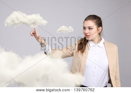 Young woman and cloud, weather forecast concept.