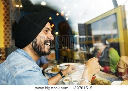 Indian Man Smiling Restaurant Concept