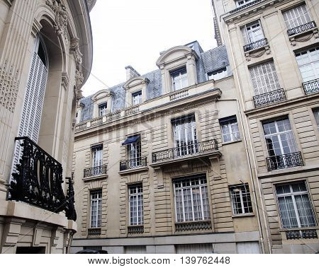 houses on french streets of Paris. citylife concept, black balcony lace