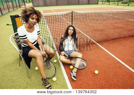 young pretty girlfriends hanging on tennis court, fashion stylish dressed swag, best friends happy smiling together, lifestyle people concept
