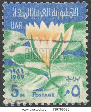 MOSCOW RUSSIA - JANUARY 2016: a post stamp printed in United Arab Republic (UAR) shows a flower devoted to Ramadan circa 1968