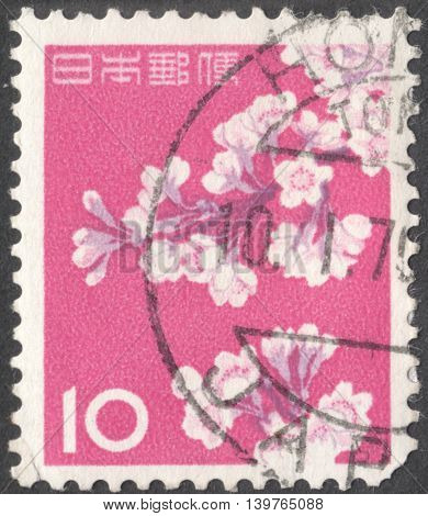 MOSCOW RUSSIA - CIRCA JANUARY 2016: a post stamp printed in JAPAN shows a sakura branch circa 1962