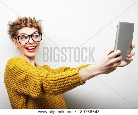 happy teenage girl wearing glasses with tablet pc computer