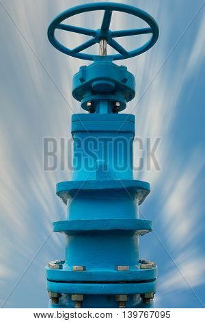 Control main valve on blue skies background Water control main valve Pipeline distribution Water pipeline distribution.