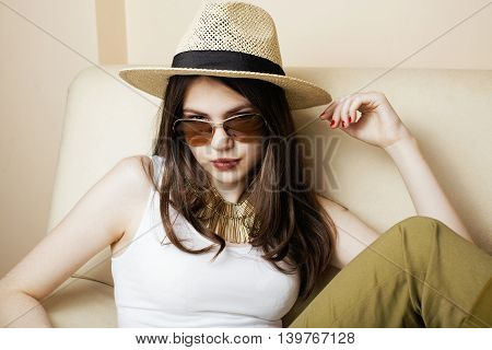 pretty young woman wearing sunglasses and summer hat, fashion people concept hipster lifestyle