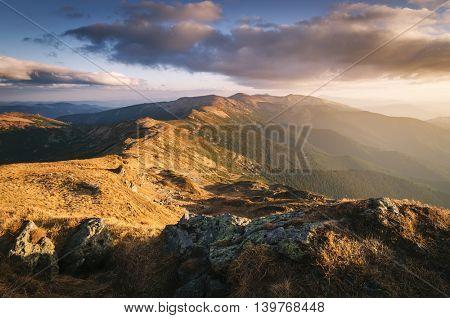Mountain ridge. Autumn landscape in the evening sun. View on the tourist route. Carpathians, Ukraine, Europe. Art processing of photos. Color toning