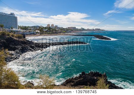 TENERIFE SPAIN - January 23 2016: Perspective view on coastline and beaches of Costa Adeje resort by sunny day.