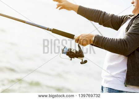 Picture of fisherman hands with rod