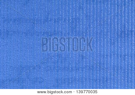 Blue embossed plastic texture background, close up