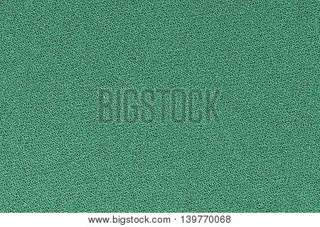 Green decorative polyester fabric texture background, close up