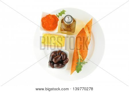 olive oil,caviar, and baguette over white plate