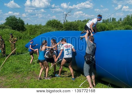 Tyumen, Russia - July 9, 2016: Steel Character extreme race on Voronino Hill. Athletes overcome inflatable obstacle