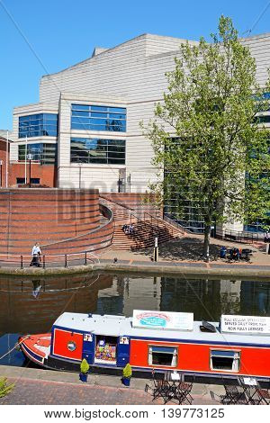 BIRMINGHAM, UNITED KINGDOM - JUNE 6, 2016 - View towards the rear of the ICC with a narrowboat cafe on the canal in the foreground at Brindleyplace Birmingham England UK Western Europe, June 6, 2016.