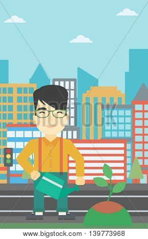 An asian young man watering a tree on a city background. Eco-friendly man takes care of the environment. Vector flat design illustration. Vertical layout.