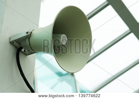 Wall speaker, white metal, close-up.