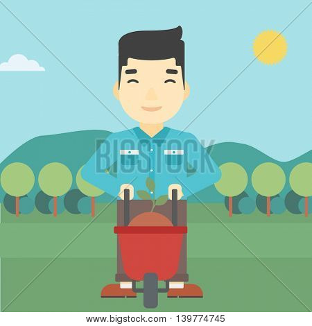 An asian young man standing with a plant and soil in a wheelbarrow on the background of mountain landscape. Vector flat design illustration. Square layout.