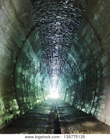 Inside of a grungy tunnel, vertical photo
