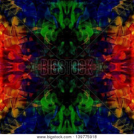 Fascinated blue green and red background made of Scarlet Macaw parrot bird feathers exotic texture