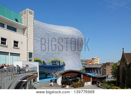 BIRMINGHAM, UNITED KINGDOM - JUNE 6, 2016 - View of the Selfridges building in the Bullring with people enjoying the sunshine Birmingham England UK Western Europe, June 6, 2016.
