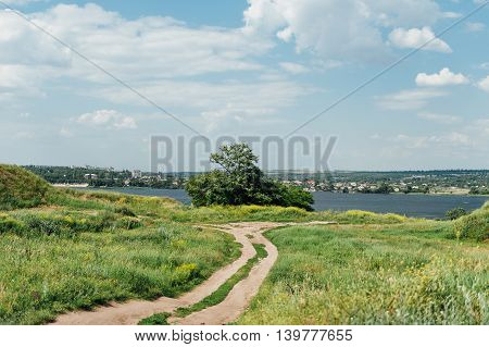 Country road through the fields leading to the Dnieper River