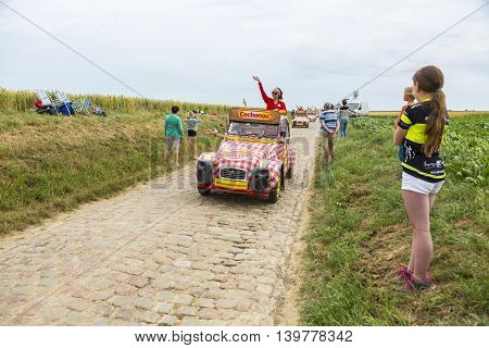 Quievy,France - July 07 2015: Cochonou Caravan during the passing of the Publicity Caravan on a cobblestone road in the stage 4 of Le Tour de France on July 7 2015 in Quievy France. Cochonou is an important French brand of short dry sausages.