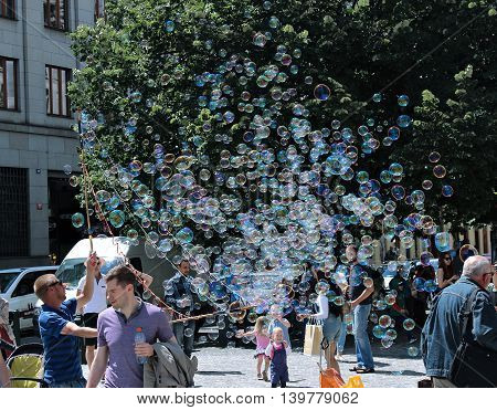 PRAGUE, CZECH REPUBLIC - JUNE 16, 2016: Holiday soap bubbles in the street in Prague