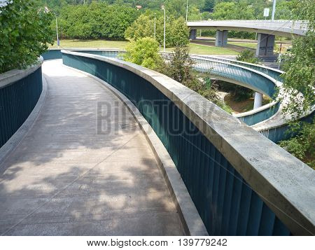 Pedestrian Bridge With A Round Spiral Acces