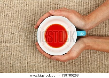 Two Woman Hands Holding Cup Of Black Red Tea