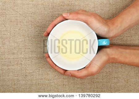 Two Woman Hands Holding Cup Of Green Tea