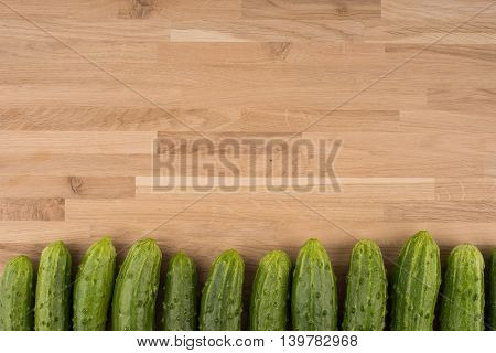 Cucumbers on a wooden background.Cucumbers on a wooden background.