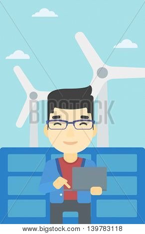 An asian worker of solar power plant and wind farm. Man working on laptop on a background of solar power plant and wind turbines. Vector flat design illustration. Vertical layout.