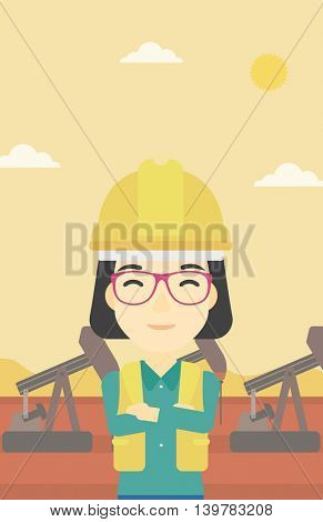 An asian female oil worker in uniform and helmet. An oil worker with crossed arms. An oil worker standing on a background of pump jack. Vector flat design illustration. Vertical layout.