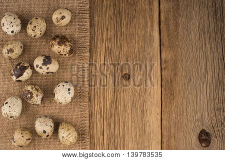 quail eggs/quail eggs.Texture of wood background closeup