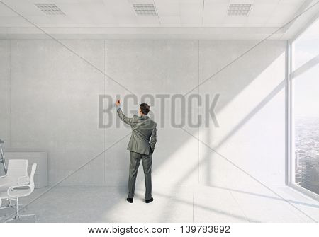 Businessman in office draw on wall  . Mixed media
