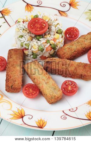 Breaded veggie sticks served with cooked rice