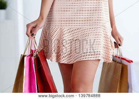 Slender Walking Legs Of Woman In Dress