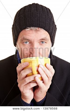 Man Drinking Coffee In Winter