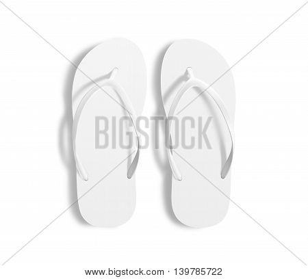 Pair of blank white beach slippers design mockup clipping path 3d illustration. Home plain flops mock up template top view. Clear bath sandal display. Bed shoes accessory footwear. Rubber flipflops