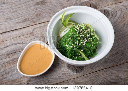 Green chuka seaweed salad served with sesame seed and sauce