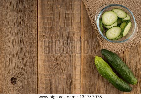 cucumber slices on wooden background.Cucumbers on a wooden background.