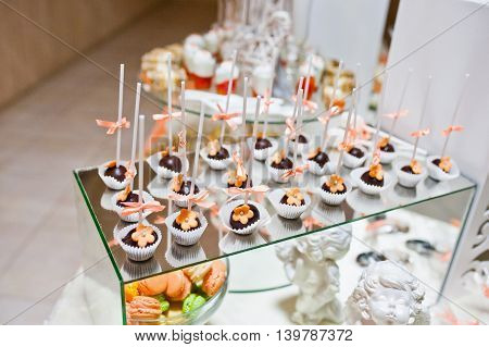 Sweet Candies And Cupcakes On Wedding Reception