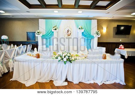 Wedding decor on table of newlyweds at wedding
