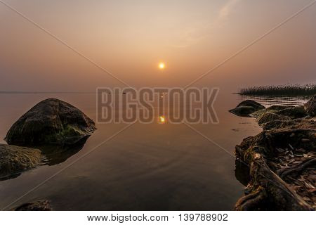 Summer evening landscape on the big lake of Pleshcheevo to Pereslavl Zalessky in warm colors.