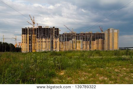 Industrial landscape construction of prefabricated houses with cranes