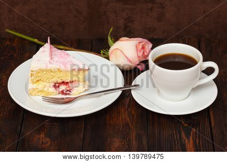 Cake Slice And Coffee Cup With Rose On Wooden Background
