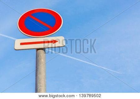 No parking traffic sign with clear blue sky background.